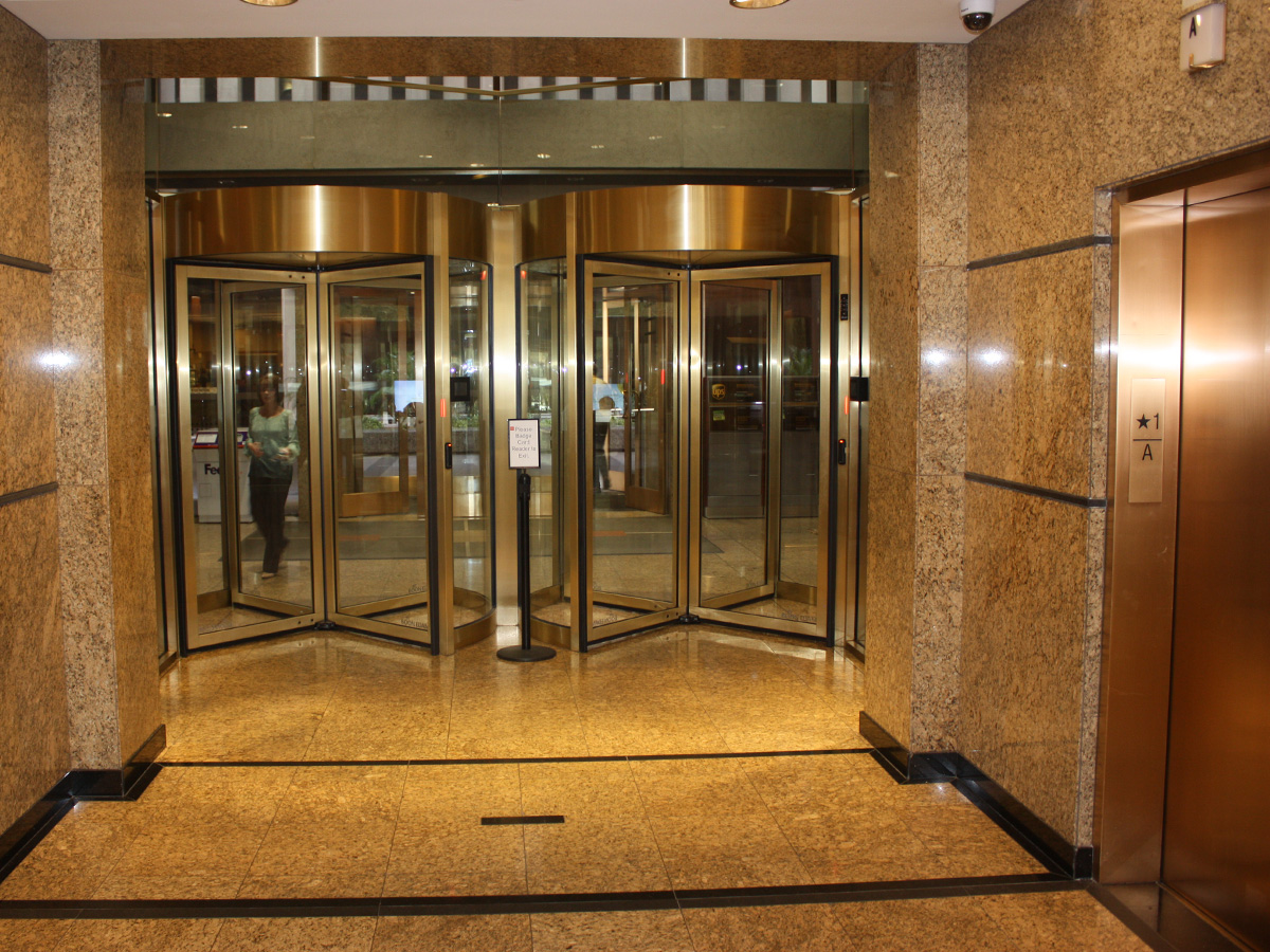 interior view of new automatic revolving doors accessing elevators
